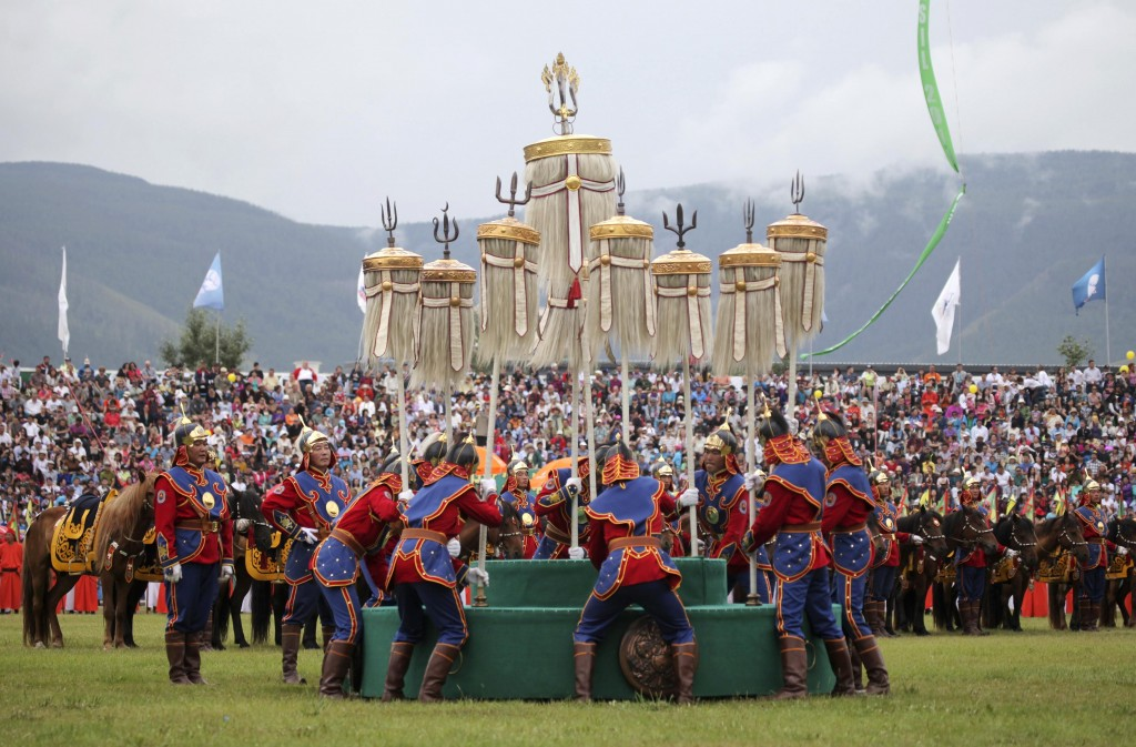 Mongolians place the Nine Flags during the annual Naadam Festival in Ulan Bator